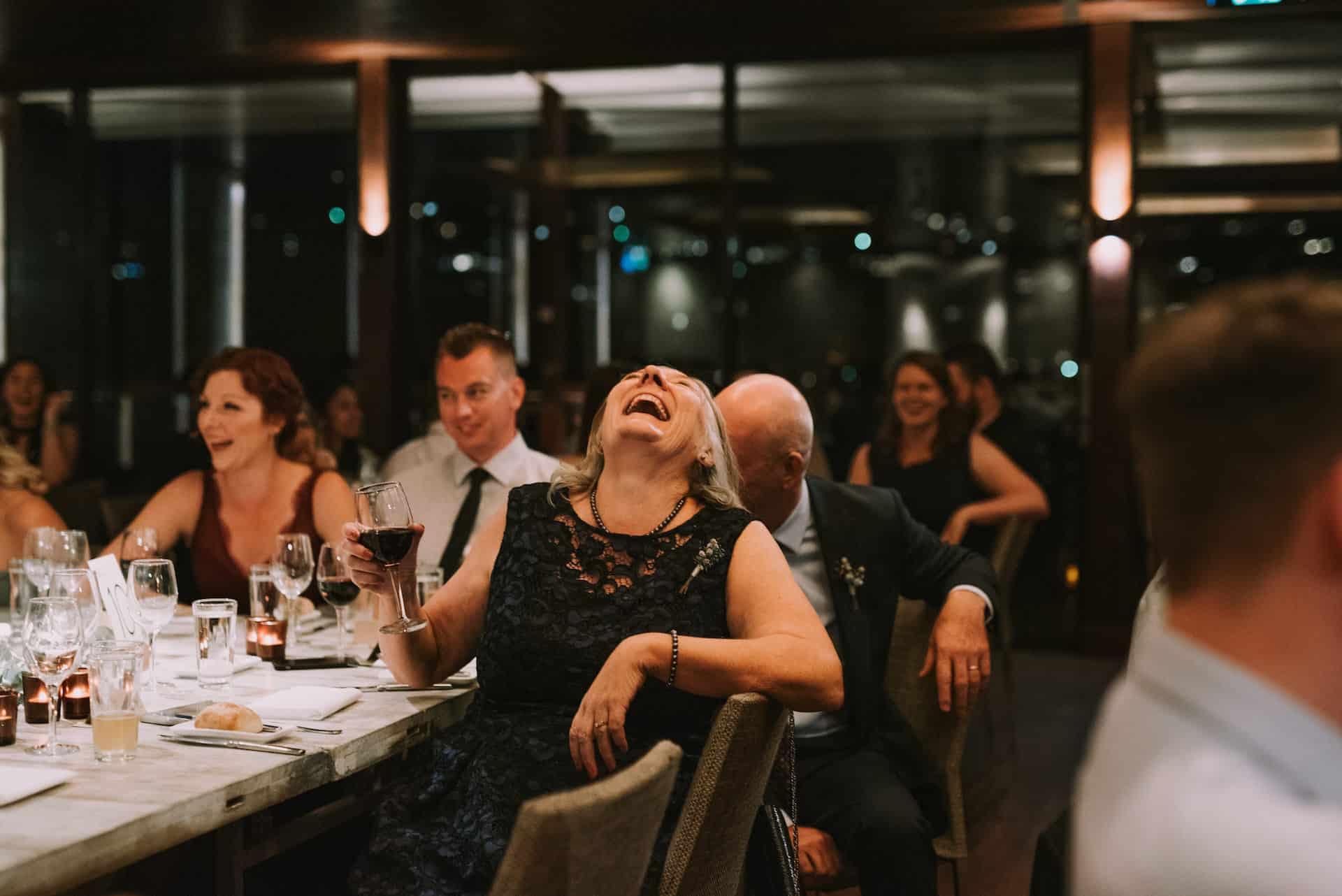 mother of the groom cannot contain her laughter during wedding reception at Zest Waterfront Venues, Mosman | photographed by Angus Porter Photography