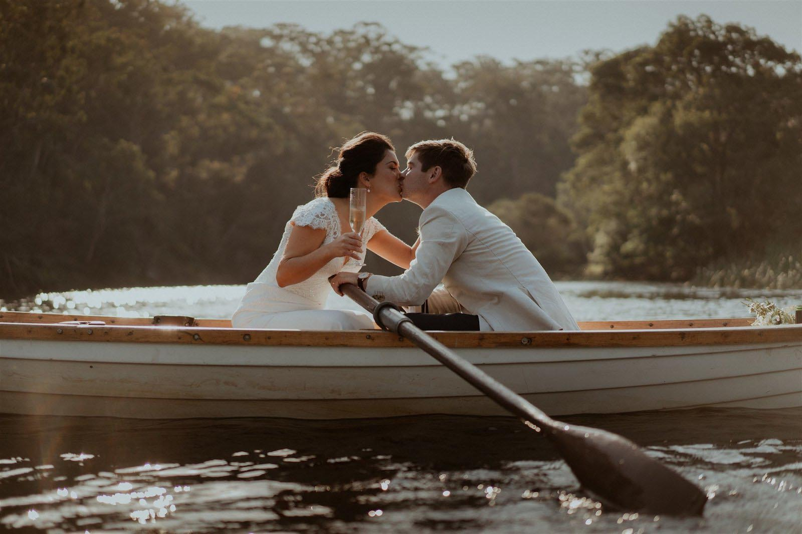 newlyweds at Audley Dance Hall kissing on hire boat